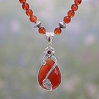 Carnelian and garnet pendant necklace, 'Leafy Radiance' - Carnelian and Garnet Beaded Pendant Necklace from India