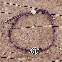 Sterling silver pendant bracelet, 'Om Saga in Purple' - Sterling Silver and Purple Cord Om Pendant Bracelet