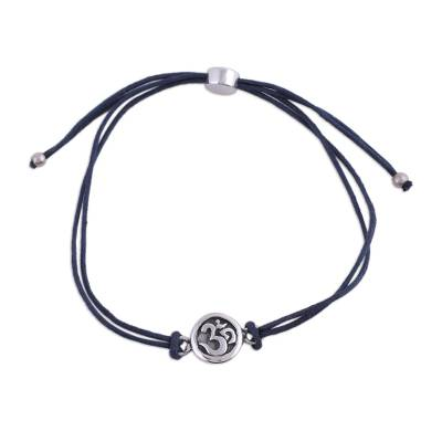 Sterling silver pendant bracelet, 'Om Saga in Blue' - Sterling Silver and Blue Cotton Cord Om Pendant Bracelet