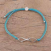 Sterling silver pendant bracelet, 'For Ever and Ever in Sky Blue' - Sterling Silver Infinity Bracelet in Sky Blue from India