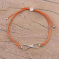 Sterling silver pendant bracelet, 'For Ever and Ever in Orange' - Sterling Silver Infinity Bracelet in Orange from India