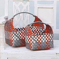 Recycled plastic baskets, 'Household Cradles' (pair) - Handwoven Recycled Plastic Baskets from India