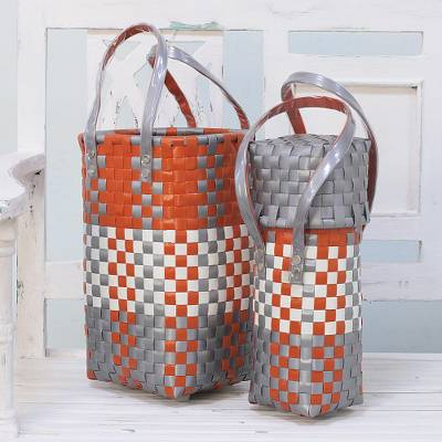 Recycled plastic bottle holders, 'Picnic Outing' (pair) - Two Handcrafted Recycled Plastic Bottle Holders from India