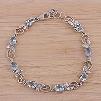 Blue topaz link bracelet, 'Blue Shimmer' - Blue Topaz Rhodium Plated Sterling Silver Link Bracelet