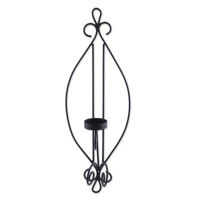 Iron wall sconce, 'Illuminating Beauty' - Handcrafted Black Wrought Iron Tealight Wall Sconce
