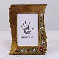 Teakwood photo frame, 'Wave of Memories' (4x6) - 4x6 Teakwood Wavy Photo Frame with Floral Motifs from India