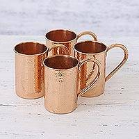 Copper mugs, 'Good Times' (set of 4) - Four Handcrafted Hammered Copper Mugs from India