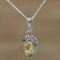 Rhodium plated citrine and emerald pendant necklace,