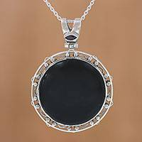 Onyx and garnet pendant necklace, 'Midnight Circle' - Onyx and Garnet Adjustable Pendant Necklace from India
