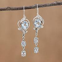 Blue topaz dangle earrings, 'Sparkling Beauty' - Rhodium Plated Blue Topaz Dangle Earrings from India