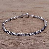 Rhodium plated tanzanite tennis-style bracelet, 'Smooth Sparkle' - Rhodium Plated Tanzanite Tennis-Style Bracelet from India