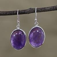 Amethyst dangle earrings, 'Glowing Delight' - Oval Amethyst and Silver Dangle Earrings from India