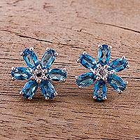 Rhodium plated blue topaz button earrings, 'Azure Daisies' - Rhodium Plated Blue Topaz Button Earrings from India