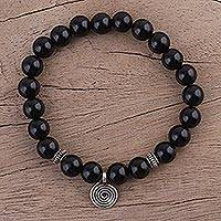 Onyx beaded stretch bracelet, 'Midnight Swirl' - Onyx and Silver Beaded Stretch Bracelet from India