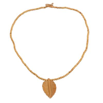 Wood pendant necklace, 'Mulberry Leaf' - Hand Carved Wood Beaded Leaf Pendant Necklace