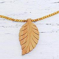 Wood pendant necklace, 'Curry Leaf' - Leaf Motif Pendant Necklace Handmade from Wood