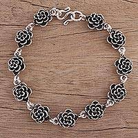 Sterling silver link bracelet, 'Rose Garland' - Floral Sterling Silver Link Bracelet from India
