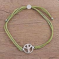 Sterling silver pendant bracelet, 'Peaceful Gleam in Green' - Sterling Silver Peace Pendant Bracelet in Green from India