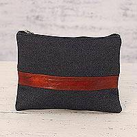 Leather accent denim cosmetic bag,