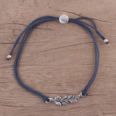 Sterling silver pendant bracelet, 'Blue Leaves in Winter' - India Dark Blue Cord Bracelet with Sterling Silver Leaves