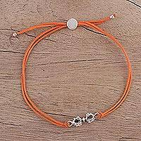 Sterling silver pendant bracelet, 'Vajra in Orange' - Vajra Theme Orange Cotton Bracelet with Sterling Silver