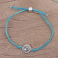 Sterling silver pendant bracelet, 'Aqua Surya Blaze' - Sterling Silver Sun Face Bracelet with Aqua Cotton Cords