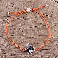 Sterling silver pendant bracelet, 'Orange Jali Hamsa' - Orange Cotton Cord Bracelet with a Sterling Silver Hamsa
