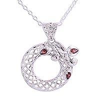 Garnet pendant necklace, 'Crimson Wreath' - Handmade Floral Garnet Wreath Pendant Necklace from India