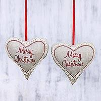 Cotton ornaments, 'Merry Christmas' (pair) - Two Inspirational Heart-Shaped Cotton Ornaments from India