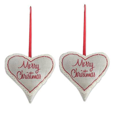 two inspirational heart shaped cotton ornaments from india merry