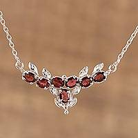 Rhodium plated garnet pendant necklace, 'Regal Scarlet' - Rhodium Plated Garnet and Silver Pendant Necklace from India