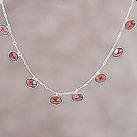 Garnet pendant necklace, 'Twinkling Red' - Faceted Garnet and Silver Pendant Necklace from India