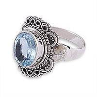 Blue topaz cocktail ring, 'Glittering Infinity' - Sparkling Blue Topaz Cocktail Ring from India