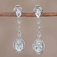 Rhodium plated blue topaz dangle earrings, 'Glacial Luster' - Blue Topaz Rhodium Plated Sterling Silver Dangle Earrings