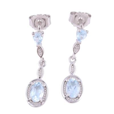 Blue Topaz Rhodium Plated Sterling Silver Dangle Earrings