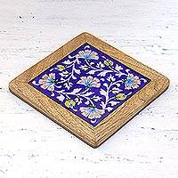 Ceramic and wood trivet, 'Floral Harmony' - Mango Wood and Ceramic Floral Trivet from India