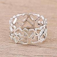 Sterling silver band ring, 'Harmony of Hearts' - Sterling Silver Heart Motif Band Ring Handcrafted in India