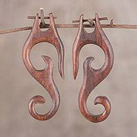 Ebony wood drop earrings, 'Serpentine Beauty' - Hand-Carved Serpentine Beauty Ebony Wood Drop Earrings