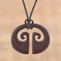 Ebony wood pendant necklace, 'Balanced Energy' - Hand Carved Ebony Wood Abstract Pendant Necklace