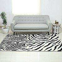 Hand-tufted wool area rug, 'Zebra Buddies' - Black and Ivory Two Zebras Hand Tufted Wool Area Rug