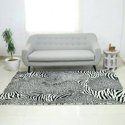 Hand-tufted wool area rug, 'Wild Harmony' - Zebra and Leopard Black and White Hand Tufted Wool Area Rug