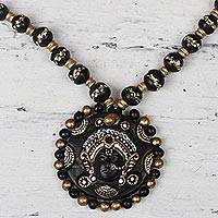 Ceramic pendant necklace, 'Divine Durga in Black' - Hand-Painted Black and Gold Ceramic Durga Goddess Necklace