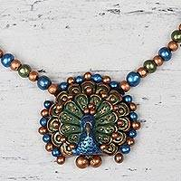 Ceramic pendant necklace, 'Peacock Elegance' - Hand-Painted Blue Green and Gold Peacock Ceramic Necklace