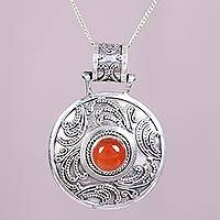 Carnelian pendant necklace, 'Sunspot' - Handcrafted Carnelian and Sterling Silver Pendant Necklace