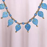 Coconut shell beaded necklace, 'Leafy Glamour' - Blue and Metallic Golden Beaded Leaf Coconut Shell Necklace
