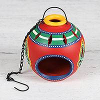 Ceramic tealight holder, 'Festive Glow' - Multicolored Ceramic Hanging Tealight Holder from India