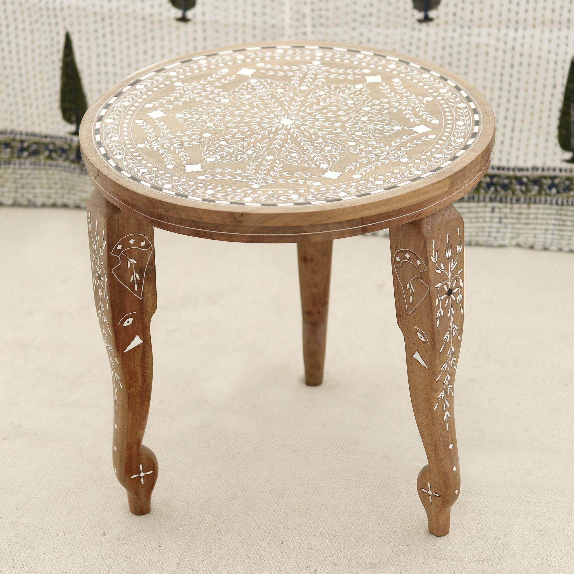 Handmade jamun wood end table with leaf motifs from india elephant majesty