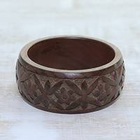 Wood bangle bracelet, 'Connected Garden' - Hand Carved Floral Motif Wood Bangle Bracelet from India