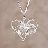 Sterling silver pendant necklace, 'Flower in the Heart' - Sterling Silver Heart and Floral Design Necklace from India