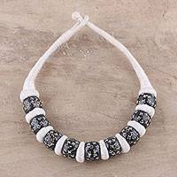 Bone beaded necklace, 'Amongst the Stars' - Star Carved Black Buffalo Bone White Cotton Beaded Necklace